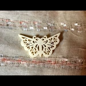 Jewelry - Carved cream colored plastic butterfly brooch